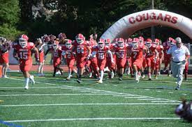 Cherry Hill East Cougars running out to start their senior day game against Princeton high school.