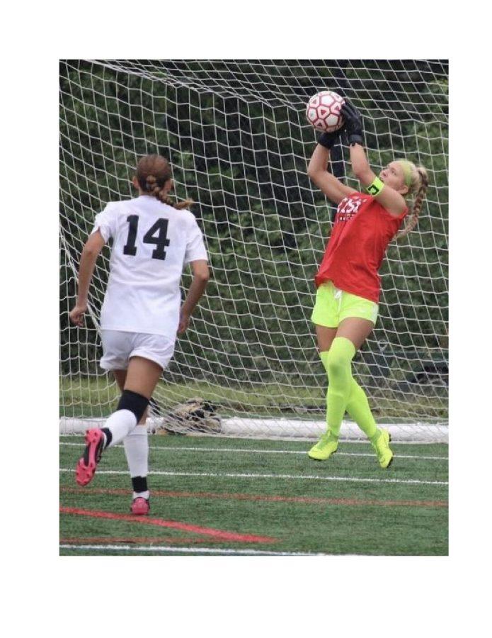 Laura Eyre (22) playing goalie for the Cherry Hill East Girls Soccer Varsity team