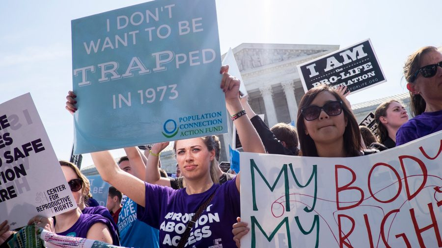 Activists gather to protest restrictive abortion laws.